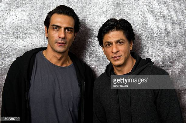 Arjun Rampal and Shah Rukh Khan poses for a portrait before the premiere of the Bollywood film 'RA One' at the Montcalm Hotel on October 25 2011 in...
