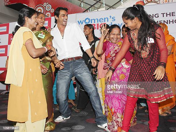 Arjun Rampal dancing with cancer patients during the CPAA Women's Day Celeberations at IMAX Wadala in Mumbai