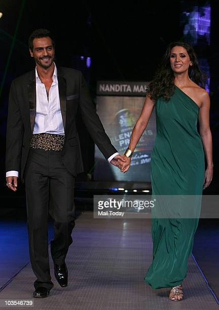 Arjun Rampal walks the ramp with wife Mehr Jessia at the Blender's Pride Fashion Tour in New Delhi on August 22 2010