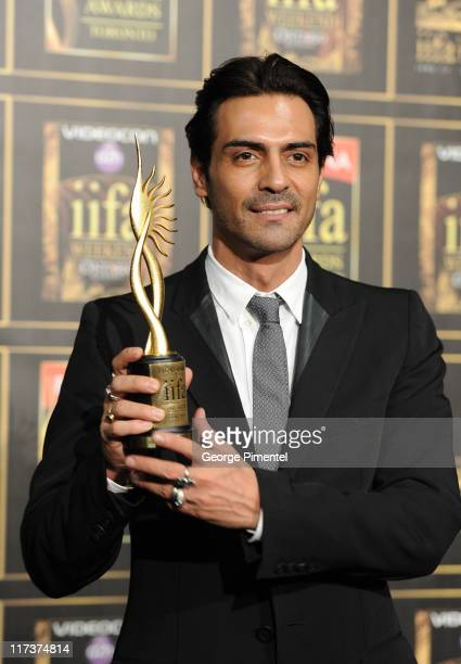 Arjun Rampal wins IIAF Award for Best Male in a Supporting Role at Rogers Centre on June 25 2011 in Toronto Canada