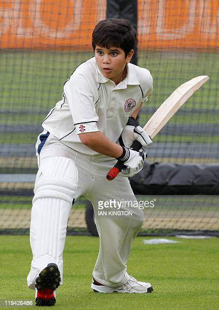 Arjun son of India's Sachin Tendulkar practices during an India training session at Lord's Cricket Ground in London on July 20 2011 England are due...