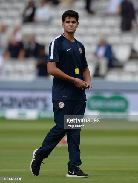 Arjun Tendulkar walks on the field before the second day of the 2nd Specsavers Test Match between England and India at Lord's Cricket Ground on...