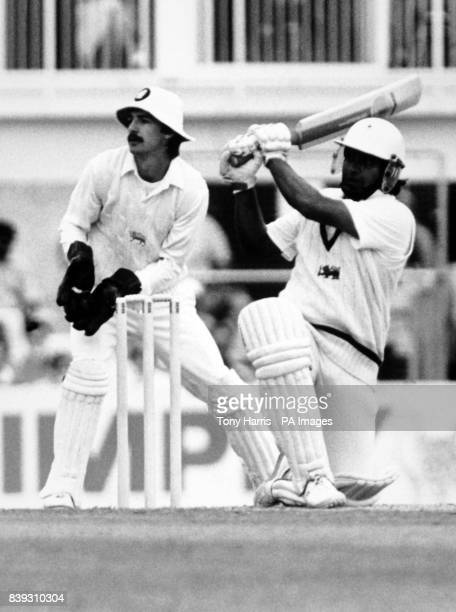 Arjuna Ranatunga confidently dispatches a delivery from Victor Marks England's new wicketkeeper Jack Russell is in the background