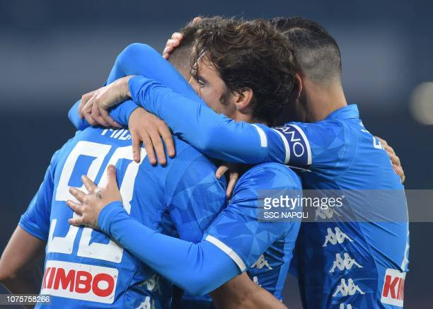 Arkadius Milik of Napoli celebrates with teamates after scoring the second goal of his team during the Serie A match between SSC Napoli and Bologna...