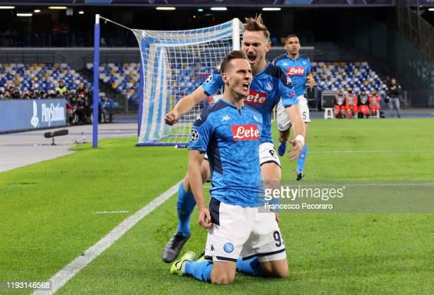 Arkadiusz Milik and Fabian Ruiz celebrate the 10 goal scored by Arkadiusz Milik during the UEFA Champions League group E match between SSC Napoli and...