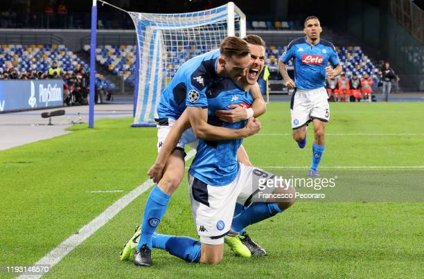 Arkadiusz Milik and Fabian Ruiz celebrate the 10 goal scored by Arkadiusz Milik during the UEFA Champions League group E match between SSC Napoli and...