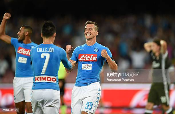 Arkadiusz Milik and Jose Maria Callejon of Napoli celebrate a goal 10 scored by Lorenzo Insigne during the Serie A match between SSC Napoli and AC...