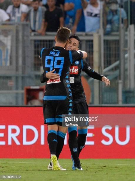 Arkadiusz Milik celebrates with José Maria Callejon after scoring goal 11 during the Italian Serie A football match between SS Lazio and SSC Napoli...