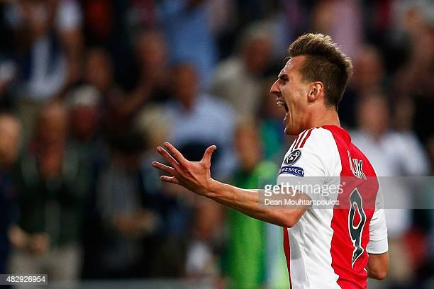 Arkadiusz Milik of Ajax celebrates scoring his teams first goal of the game during the third qualifying round 2nd leg UEFA Champions League match...