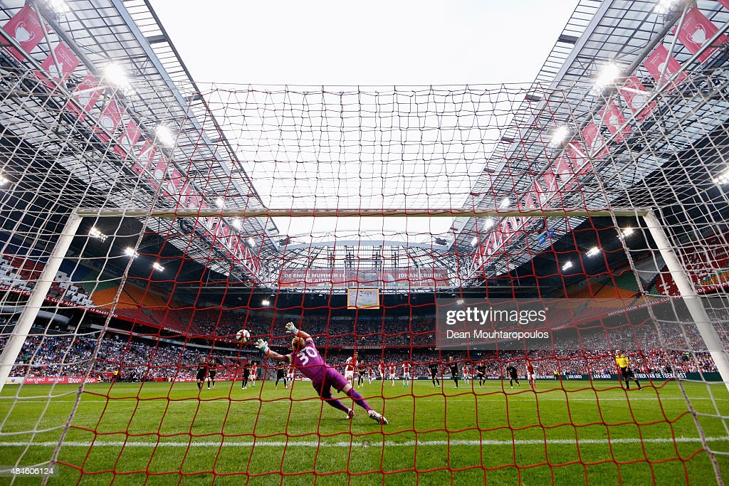 Arkadiusz Milik of Ajax takes and scores a penalty past Goalkeeper, Vlastimil Hruby of FK Baumit Jablonec during the UEFA Europa League play off round 1st leg match between Ajax Amsterdam and FK Baumit Jablonec on August 20, 2015 in Amsterdam, Netherlands.