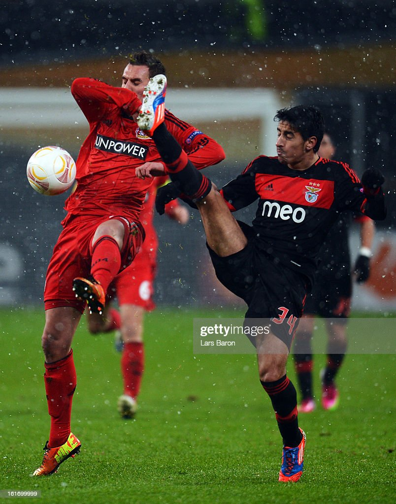 Arkadiusz Milik of Leverkusen is challenged by Andre Almeida of Benfica during the UEFA Europa League Round of 32 first leg between Bayer 04 Leverkusen and SL Benfica at BayArena on February 14, 2013 in Leverkusen, Germany.