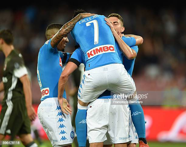 Arkadiusz Milik of Napoli and other Napoli players celebrates after scoring goal 10 during the Serie A match between SSC Napoli and AC Milan at...