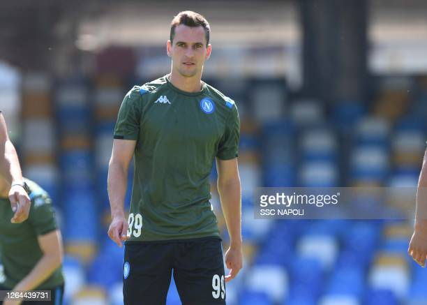 Arkadiusz Milik of Napoli attends a training session during the UEFA Champions League round of 16 second leg match between FC Barcelona and SSC...