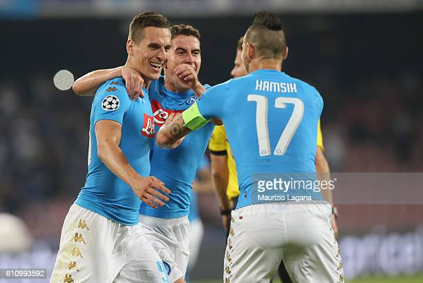 Arkadiusz Milik of Napoli celebrates after scoring his tem'as third goal during the UEFA Champions League match between SSC Napoli and Benfica at...
