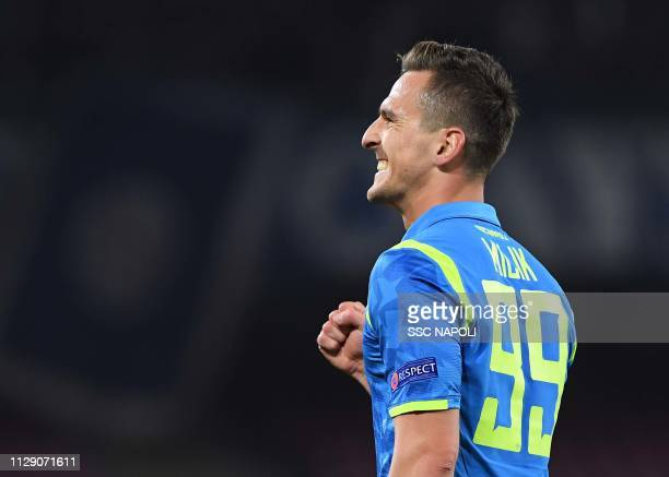 Arkadiusz Milik of Napoli celebrates after scoring the first goal during the UEFA Europa League Round of 16 First Leg match between SSC Napoli and...