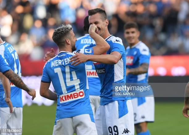 Arkadiusz Milik of Napoli celebrates with teammate Dries Mertens after scoring the first goal of his team during the Serie A match between SPAL and...