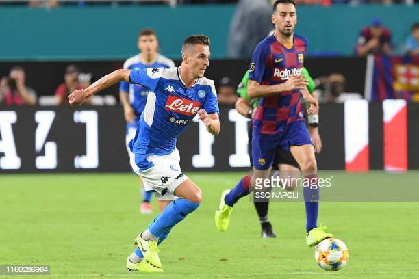 Arkadiusz Milik of Napoli controls the ball during the preseason friendly match between FC Barcelona and SSC Napoli at Hard Rock Stadium on August 7...