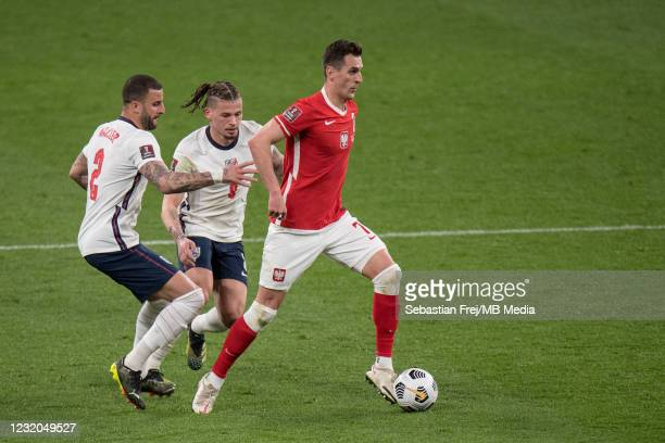 Arkadiusz Milik of Poland and Kyle Walker and Kalvin Phillips of England in action during the FIFA World Cup 2022 Qatar qualifying match between...