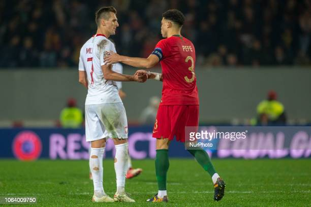 Arkadiusz Milik of Poland and Pepe of Portugal thanks each other during the UEFA Nations League A Group 3 match between Portugal and Poland at...