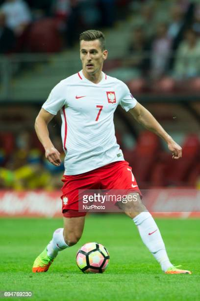 Arkadiusz Milik of Poland controls the ball during the FIFA World Cup 2018 Qualifying Group E match between Poland and Romania at PGE National...
