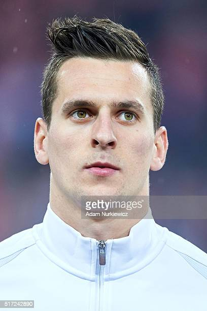 Arkadiusz Milik of Poland looks while national anthem during the international friendly soccer match between Poland and Serbia at the Inea Stadium on...