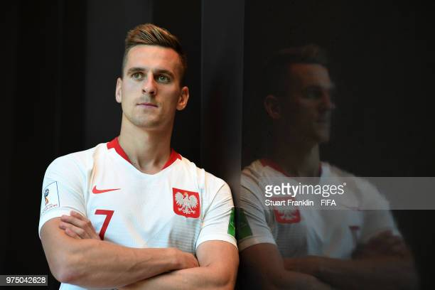 Arkadiusz Milik of Poland poses for a photograph during the official FIFA World Cup 2018 portrait session at on June 14 2018 in Sochi Russia