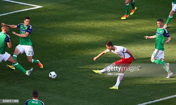 Arkadiusz Milik of Poland scores his team's first goal during the UEFA EURO 2016 Group C match between Poland and Northern Ireland at Allianz Riviera...