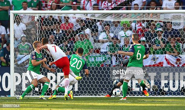 Arkadiusz Milik of Poland scores his team's first goal past Michael McGovern of Northern Ireland during the UEFA EURO 2016 Group C match between...