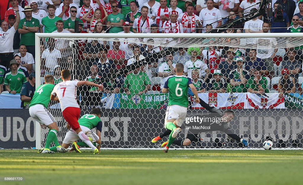 Arkadiusz Milik of Poland scores the opening goal during the UEFA EURO 2016 Group C match between Poland v Northern Ireland at Allianz Riviera Stadium on June 12, 2016 in Nice, France.