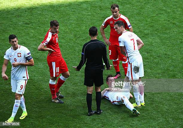 Arkadiusz Milik of Poland stretches a leg of Krzysztof Maczynski during the UEFA EURO 2016 round of 16 match between Switzerland and Poland at Stade...