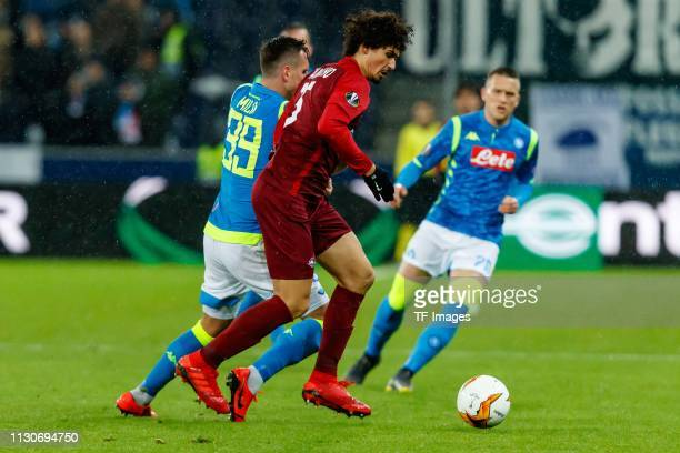 Arkadiusz Milik of SSC Napoli and Andre Ramalho of Red Bull Salzburg battle for the ball during the UEFA Europa League Round of 16 Second Leg match...