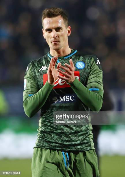 Arkadiusz Milik of SSC Napoli celebrates a victory at the end of the Serie A match between Brescia Calcio and SSC Napoli at Stadio Mario Rigamonti on...