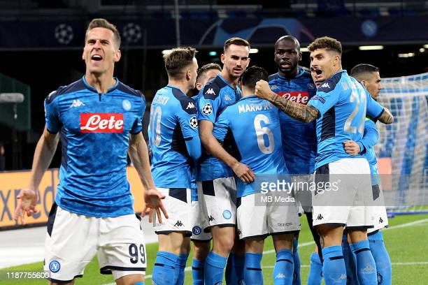 Arkadiusz Milik of SSC Napoli celebrates after his goal 30 With team mates during the UEFA Champions League group E match between SSC Napoli and KRC...