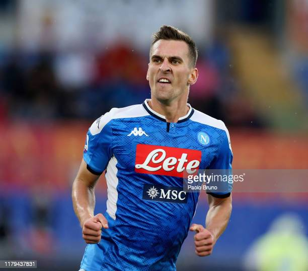 Arkadiusz Milik of SSC Napoli celebrates after scoring his team's first goal during the Serie A match between AS Roma and SSC Napoli at Stadio...