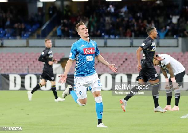Arkadiusz Milik of SSC Napoli celebrates after scoring the 20 goal beside the disappointment of Bruno Alves and Luigi Sepe of Parma Calcio during the...