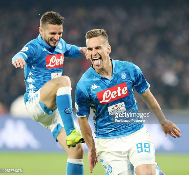 Arkadiusz Milik of SSC Napoli celebrates after scoring the 21 with teammate Dries Mertens during the Serie A match between SSC Napoli and Bologna FC...
