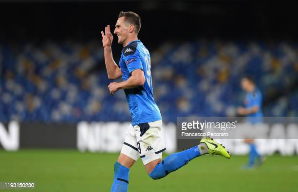 Arkadiusz Milik of SSC Napoli celebrates after scoring the 30 goal during the UEFA Champions League group E match between SSC Napoli and KRC Genk at...