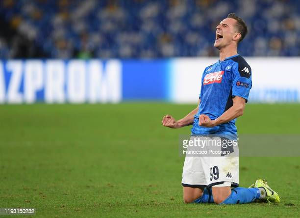 Arkadiusz Milik of SSC Napoli celebrates after scoring the 3-0 goal during the UEFA Champions League group E match between SSC Napoli and KRC Genk at...