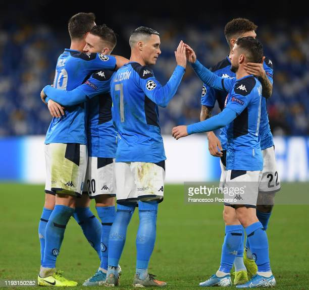 Arkadiusz Milik of SSC Napoli celebrates after scoring the 30 goal with teammates during the UEFA Champions League group E match between SSC Napoli...