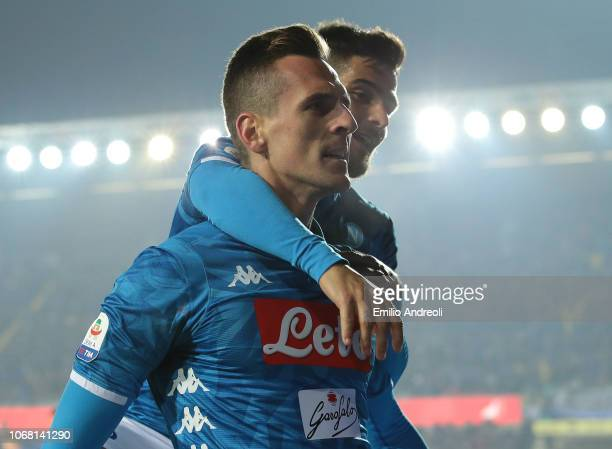 Arkadiusz Milik of SSC Napoli celebrates his goal with his teammate Lorenzo Insigne during the Serie A match between Atalanta BC and SSC Napoli at...