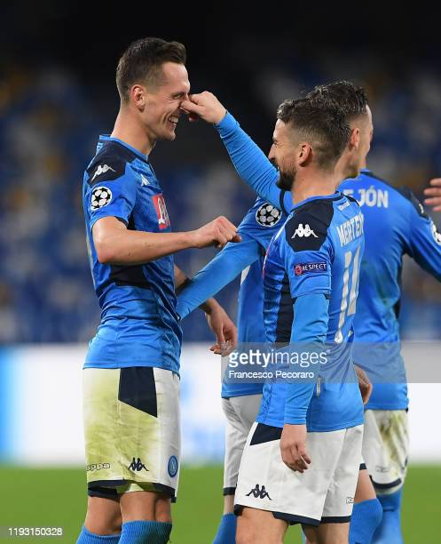 Arkadiusz Milik of SSC Napoli celebrates the 3-0 goal with teammate Dries Mertens during the UEFA Champions League group E match between SSC Napoli...