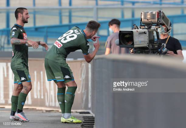 Arkadiusz Milik of SSC Napoli celebrates with his team-mate Matteo Politano after scoring the opening goal during the Serie A match between Hellas...