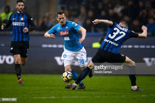 Arkadiusz Milik of SSC Napoli competes for the ball with Milan Skriniar of FC Internazionale during the Serie A football match between FC...