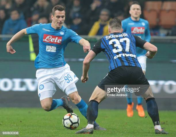 Arkadiusz Milik of SSC Napoli is challenged by Milan Skriniar of FC Internazionale Milano during the serie A match between FC Internazionale and SSC...
