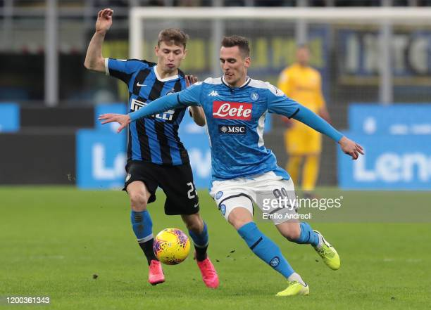 Arkadiusz Milik of SSC Napoli is challenged by Nicolo Barella of FC Internazionale during the Coppa Italia Semi Final match between FC Internazionale...
