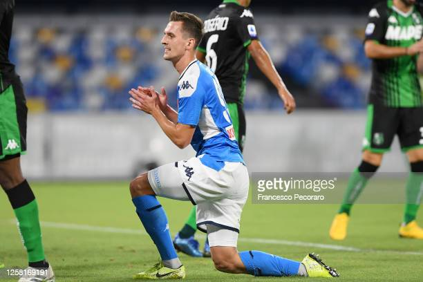 Arkadiusz Milik of SSC Napoli stands disappointed during the Serie A match between SSC Napoli and US Sassuolo at Stadio San Paolo on July 25, 2020 in...