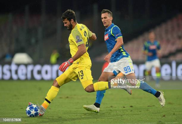 Arkadiusz Milik of SSC Napoli vies Alisson of Liverpool during the Group C match of the UEFA Champions League between SSC Napoli and Liverpool at...