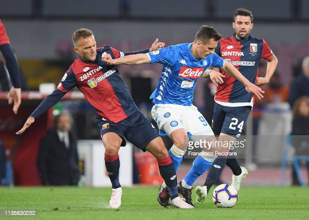 Arkadiusz Milik of SSC Napoli vies Domenico Criscito of Genoa CFC during the Serie A match between SSC Napoli and Genoa CFC at Stadio San Paolo on...