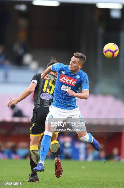 Arkadiusz Milik of SSC Napoli vies player of Frosinone Calcio during the Serie A match between SSC Napoli and Frosinone Calcio at Stadio San Paolo on...