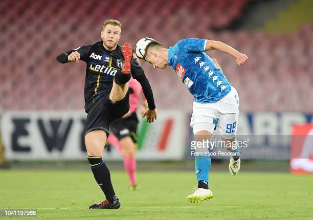 Arkadiusz Milik of SSC Napoli vies Riccardo Gagliolo of Parma Calcio during the serie A match between SSC Napoli and Parma Calcio at Stadio San Paolo...